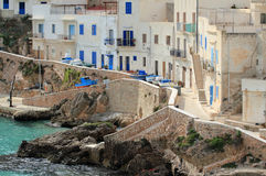 Via Grotte Levanzo - Egadi islands. Houses on the sea in the small fishing village of levanzo - Sicily Stock Photography