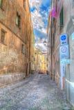 Via nella vecchia città di Alghero un chiaro giorno Fotografia Stock Libera da Diritti