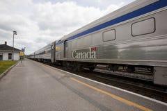 Via Passenger Train Sitting at Station stock photo