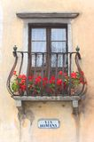Via Romana - Italian balcony. A typical Italian balcony over a typical old road sign Royalty Free Stock Photography
