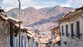 Via stretta nella vecchia vicinanza della città di Cusco, Perù Fotografia Stock