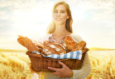 Viable woman with bread and rolls Stock Photos
