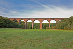 Viaduct. A red railway viaduct in a grassland with blue sky, Hartlepool, UK royalty free stock photography
