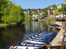Viaduct bridge over river Nidd, Knaresborough, UK. Riverside view of old viaduct bridge in Knaresborough, taken from the bank of river Nidd in bright summer Royalty Free Stock Photo