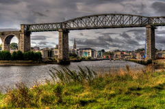 Viaduct bridge spanning a river Stock Image