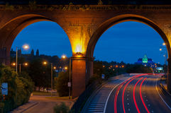 Viaduct closeup stockport. Viaduct on M60 a motor near stockport Manchester and a glass pyramid style building framed by the arch of the viaduct. Image no 114 Royalty Free Stock Images
