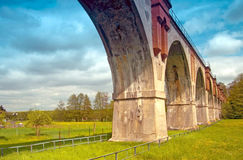 Viaduct in Nirkendorf. Old railroad bridge with arches Royalty Free Stock Photography