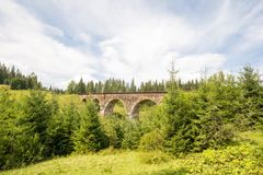 Viaduct. The old acting viaductCarpathians. Sunny weather. The mountains. Juicy Nature. Viaduct. The old acting viaductIn the Carpathians are excellent species Stock Images