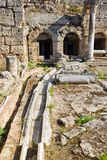 Viaduct and ruins in Corinth, Greece. Archaeology background Royalty Free Stock Photography