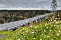 Viaduct steel concrete highway bridge in russian forest, sunny d Stock Photography