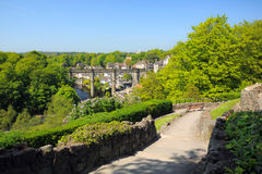 Viaduct view from hill, Knaresborough, England. Wide view of old viaduct bridge in Knaresborough, taken from the castle hill on the bank of river Nidd in bright Stock Image