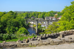 Viaduct view from hill, Knaresborough, England. Wide view of old viaduct bridge in Knaresborough, taken from the castle hill on the bank of river Nidd in bright Royalty Free Stock Photo