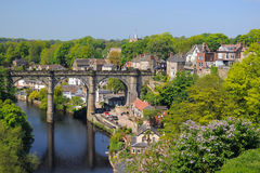 Viaduct view from hill, Knaresborough, England. Wide view of old viaduct bridge in Knaresborough, taken from the castle hill on the bank of river Nidd in bright Stock Photo