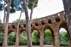 Viaducto arcs and trees in Park Guell at Barcelona Royalty Free Stock Images