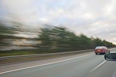 Viaggiando all'alta velocità su una strada principale Fotografia Stock