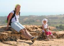 Viaggiando con un bambino Fotografie Stock