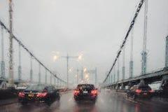 Viaggiando in pioggia Fotografie Stock