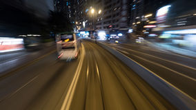 Viaggiando in tram nella notte Hong Kong Fotografia Stock