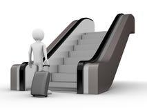 Viaggiatore con un circuito di collegamento prima della scala mobile Immagini Stock Libere da Diritti