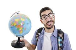 Viaggiatore confuso con il globo Immagine Stock