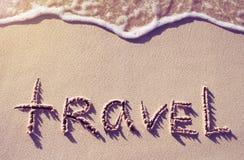 viaggio di parola scritta sulla sabbia Fotografie Stock Libere da Diritti