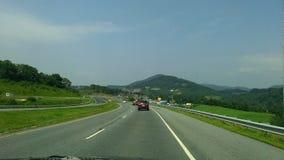 Viaggio stradale blu della cresta Immagine Stock
