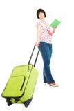 Viajante com mala de viagem e livro Imagens de Stock Royalty Free