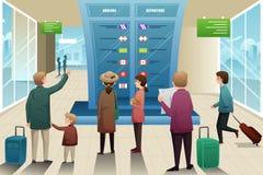 Viajantes que olham a placa da partida Foto de Stock Royalty Free
