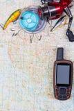 Viaje de la pesca con los trastos y el navegador de los gps Imagen de archivo libre de regalías