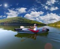 Viaje del verano en el río en canoa Imagen de archivo libre de regalías