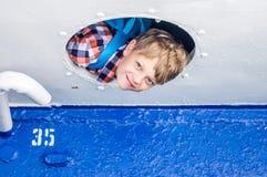 Viajero del muchacho en una nave Fotos de archivo libres de regalías
