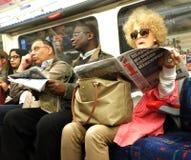 Viajeros en Londres subterráneo Fotos de archivo libres de regalías