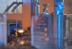 Vial and ampule glass manufacturing. Vial and ampule manufacturing in modern bio technology industry Royalty Free Stock Photos