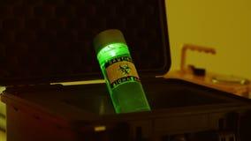 Vial of biohazard liquid in a black case stock video footage