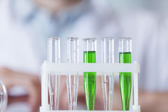 The vial with the green substance Stock Images