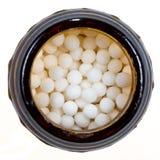 Vial with homeopathy sugar ball Royalty Free Stock Photos