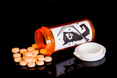 A vial of illegal pills. Royalty Free Stock Image