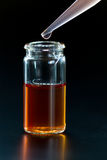 Vial liquid and a pipette Stock Photography