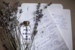 Vial with sea water. The sea is always with me. Lavender flowers, closeup stock image