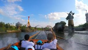 Vialand Istanbul - TURKEY 10 August 2015 - People splash into the water as they come down from a slide in a small boat. Slow Motion stock footage