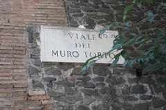 Viale del Muro Torto street name sign, Rome, Italy. Viale del Muro Torto street name sign. The Muro Torto Italian for `askew wall` is an ancient Roman supporting royalty free stock images