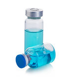 Vials with blue solution isolated on a white background. Stock Photography
