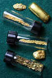 Vials of Gold Dust and Gold Nuggets. Vials of natural California gold dust and placer gold nuggets Royalty Free Stock Images