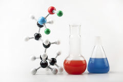 Vials with Fluid and Molecular Chain. Two Vials with colored fluid and Molecular Chain Royalty Free Stock Image