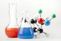 Vials witch Fluid and Molecular Chain. Two Vials witch colored fluid and Molecular Chain Royalty Free Stock Photo