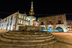 Viana do Castelo city center at night. A stone fountain and some histroic buidings behind itat night, in the main square of the Viana do Castelo city Royalty Free Stock Photos
