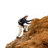 Viandante femminile sulle rocce isolate. Fotografie Stock
