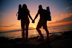 Viandanti al tramonto Fotografie Stock