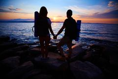 Viandanti al tramonto Immagine Stock