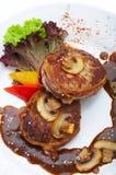 Viande avec des champignons de couche Photographie stock